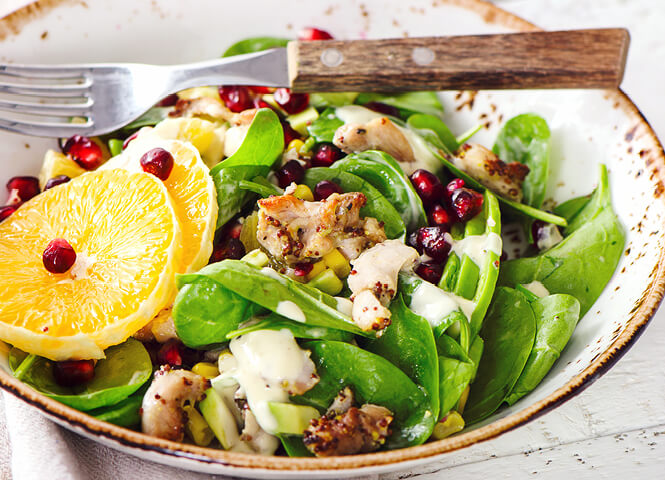 Spinach, chicken and pomegranate salad